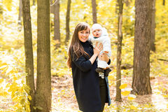 Happy young mother with little daughter in autumn Stock Images