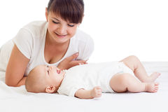 Happy young mother looking at her baby infant girl Royalty Free Stock Photography