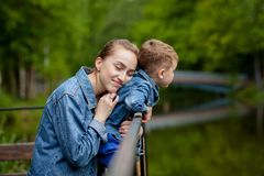 Happy young mother playing and having fun with her little baby son on warm spring or summer day in the park. Happy family concept. Mother`s day royalty free stock images
