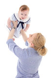 Happy young mother playing with little daughter isolated on whit Royalty Free Stock Photos