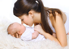 Happy young mother and sleepy baby Stock Photography
