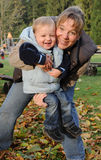 Happy young mother and son Stock Photos