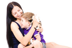 Happy young mother and son together with kittens Stock Images