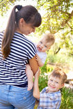 Happy young mother with two children Royalty Free Stock Image