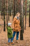 Happy young mother walking by forest. With little son Stock Image