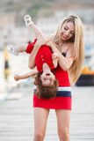 Happy young mother with a young daughter near Yacht Club Royalty Free Stock Images