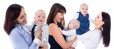 Happy young mothers playing with little kids isolated on white royalty free stock photos