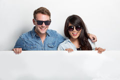 Happy Young multiculture Couple with while blank billboard  Stock Photography
