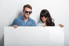 Happy Young Multiculture Couple with white blank billboard  Stock Images