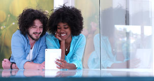 Couple relaxing together at home with tablet computer Royalty Free Stock Photography