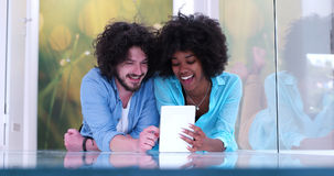 Couple relaxing together at home with tablet computer Royalty Free Stock Image