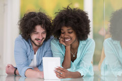 Couple relaxing together at home with tablet computer Royalty Free Stock Images