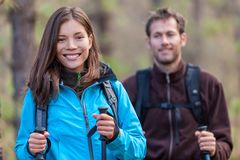 Happy young multiracial people hiking outdoors royalty free stock photos