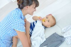 Happy young mum with baby Stock Images