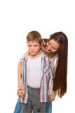 Happy young mum cheers sad son Royalty Free Stock Images