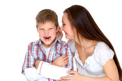 Happy young mum cheers sad son. Happy young mum cheers sad  scream son isolated on white Stock Image