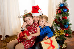 Happy Young Mum, son and daughter at Christmas Royalty Free Stock Photography