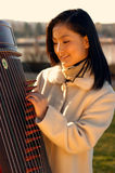 Happy Young Musician. Beautiful Asian Woman Royalty Free Stock Image