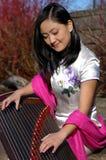 Happy Young Musician. Beautiful Asian Woman Stock Photos