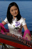 Happy Young Musician. Beautiful Asian Woman Stock Image