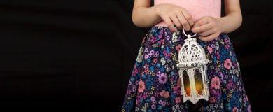 Happy young Muslim girl holding Ramadan lantern royalty free stock photos