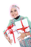 Happy young muslim woman with gift boxes Stock Image