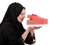 Happy young muslim woman with shopping bag and gift boxes isolated over white background Royalty Free Stock Images