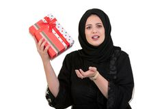 Happy young muslim woman with shopping bag and gift boxes isolated over white background Stock Images