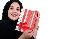Happy young muslim woman with shopping bag and gift boxes isolated over white background Royalty Free Stock Photo
