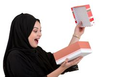 Happy young muslim woman with shopping bag and gift boxes isolated over white background Royalty Free Stock Photography