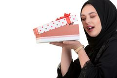 Happy young muslim woman with shopping bag and gift boxes isolated over white background Royalty Free Stock Photos