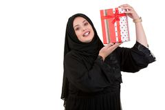 Happy young muslim woman with shopping bag and gift boxes isolated over white background Stock Image