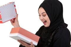 Happy young muslim woman with shopping bag and gift boxes isolated over white background Stock Photos