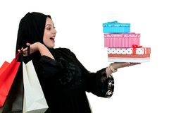 Happy young muslim woman with shopping bag and gift boxes isolated over white background Stock Photography