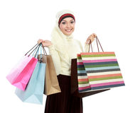 Young muslim woman with shopping bag Stock Photo