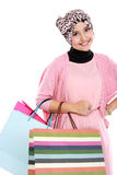Happy young muslim woman with shopping bag Royalty Free Stock Photography