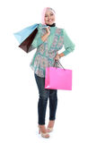 Happy young muslim woman with shopping bag Royalty Free Stock Photos