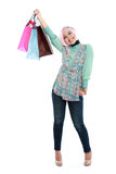 Happy young muslim woman with shopping bag Royalty Free Stock Images