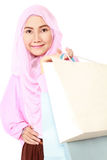 Happy young muslim woman with shopping bag. Isolated on white background Royalty Free Stock Photos