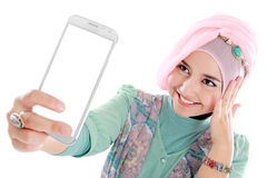 Happy young muslim woman take self portrait Stock Photo