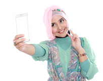 Happy young muslim woman take self portrait Stock Image