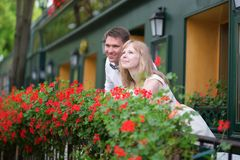 Happy young newly-wed couple on a balcony. Of their house or hotel room Stock Photo