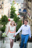 Happy young newly-wed couple on Montmartre Royalty Free Stock Photography