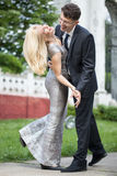 Happy young newlywed couple dancing outdoors Stock Photos