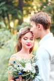 Happy young newlywed couple man buried his nose in her hair in p Stock Images