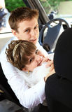 Happy young newlyweds inside car Royalty Free Stock Photography