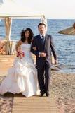 Happy young newlyweds walking Royalty Free Stock Image