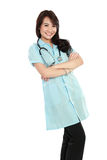Happy young nurse with arms crossed Stock Photo