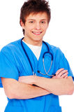 Happy young nurse boy. Portrait of a happy young nurse boy over white background Stock Images