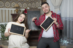 Happy young parents expecting the birth of their unborn child. Stock Photography